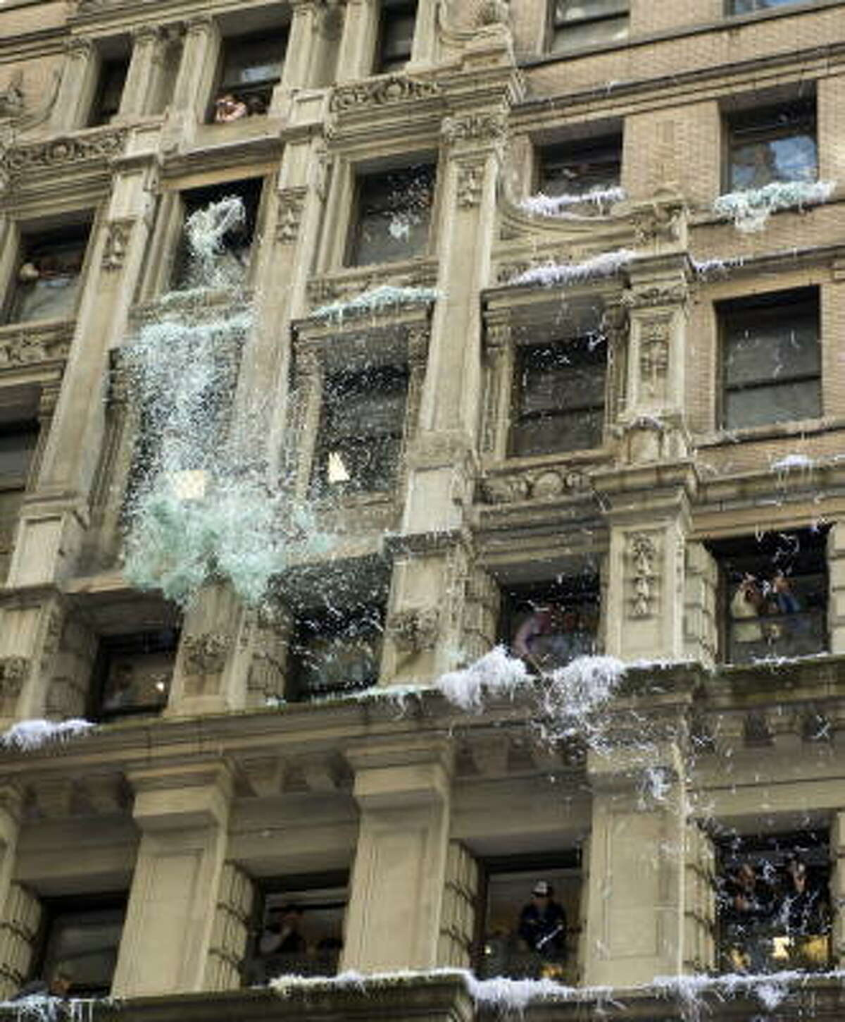 Confetti is thrown from offices during the ticker-tape parade. It has been years since the city used actual ticker-tape to celebrate its World Series.