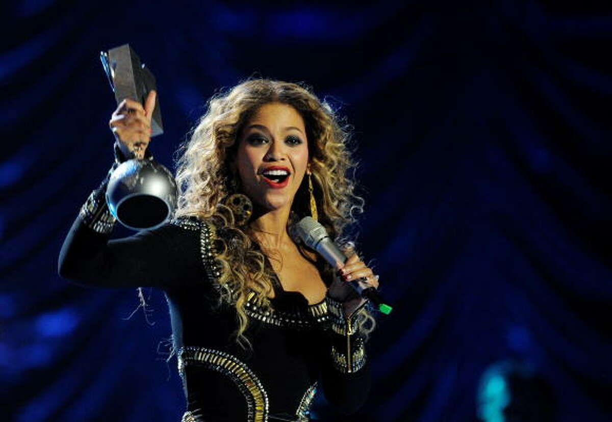 Beyonce Knowles poses after receiving one of three awards she got during the MTV Europe Music Awards. To read about more winners, click here.