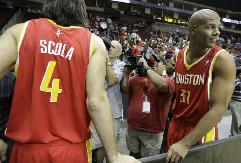 Trevor Ariza, Luis Scola, Aaron Brooks and the rest of the new-generation Rockets will pay homage to the franchise's storied past, when they play their first regular-season game in their new alternate jerseys. Photo: Melissa Phillip, Chronicle