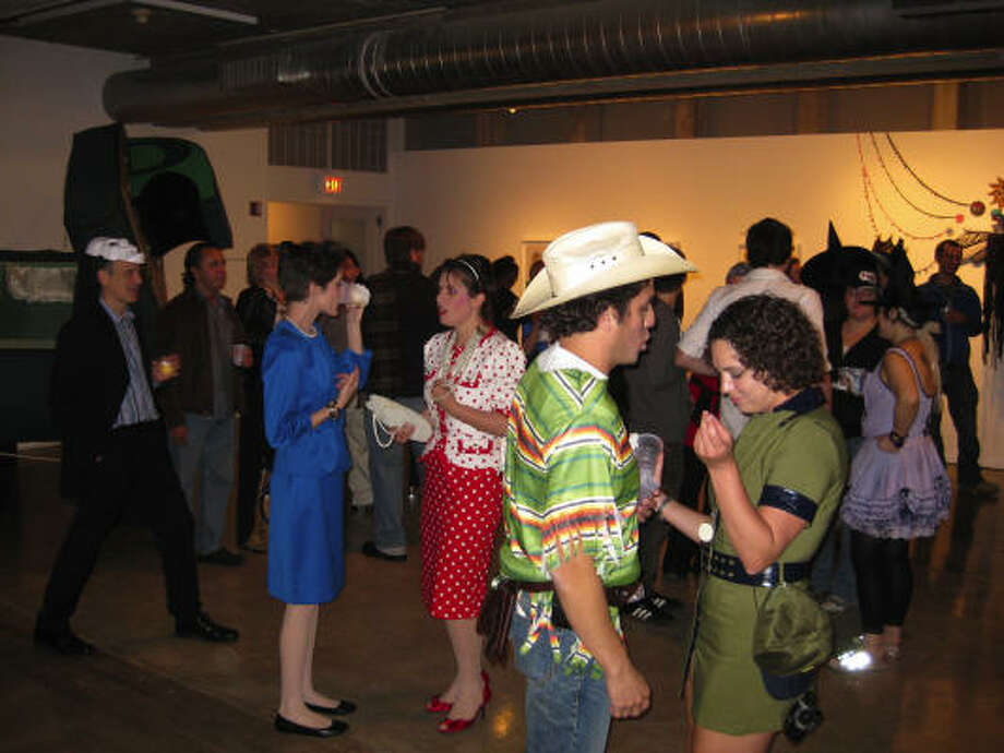 The Oct. 30 edition of the monthly Steel Lounge Underground event at the Contemporary Arts Museum Houston drew its share of costumed partiers. Photo: Douglas Britt / Chronicle
