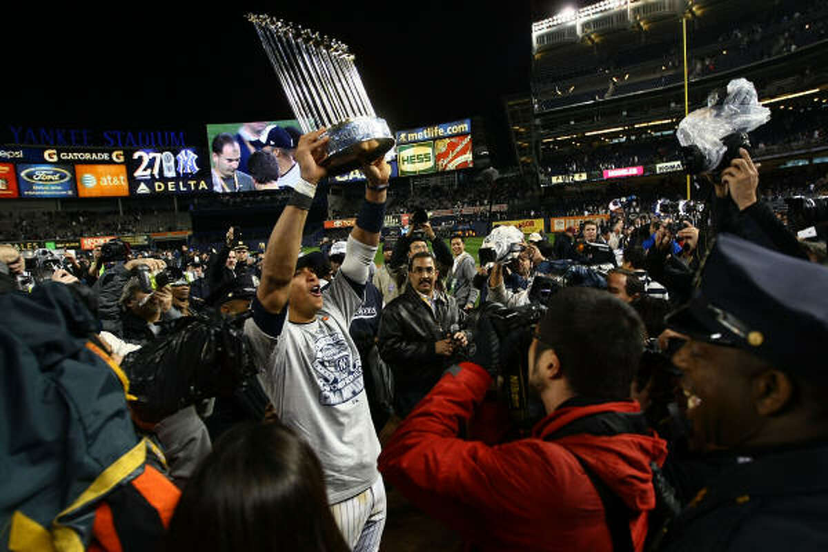 Yankees third baseman Alex Rodriguez celebrates with the trophy after their 7-3 win against the Philadelphia Phillies in Game 6 of the 2009 World Series.