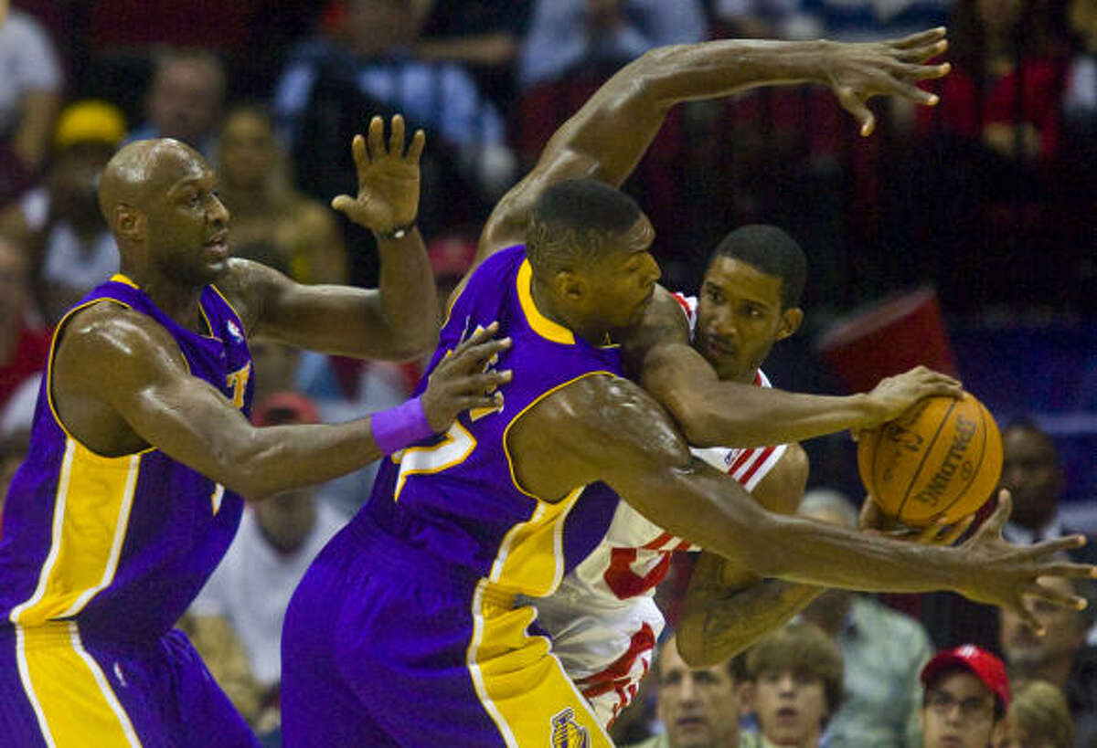 Nov. 4: Lakers 103, Rockets 102 (OT) The Lakers' Lamar Odom and teammate Ron Artest guard Rockets guard Trevor Ariza during the first half.