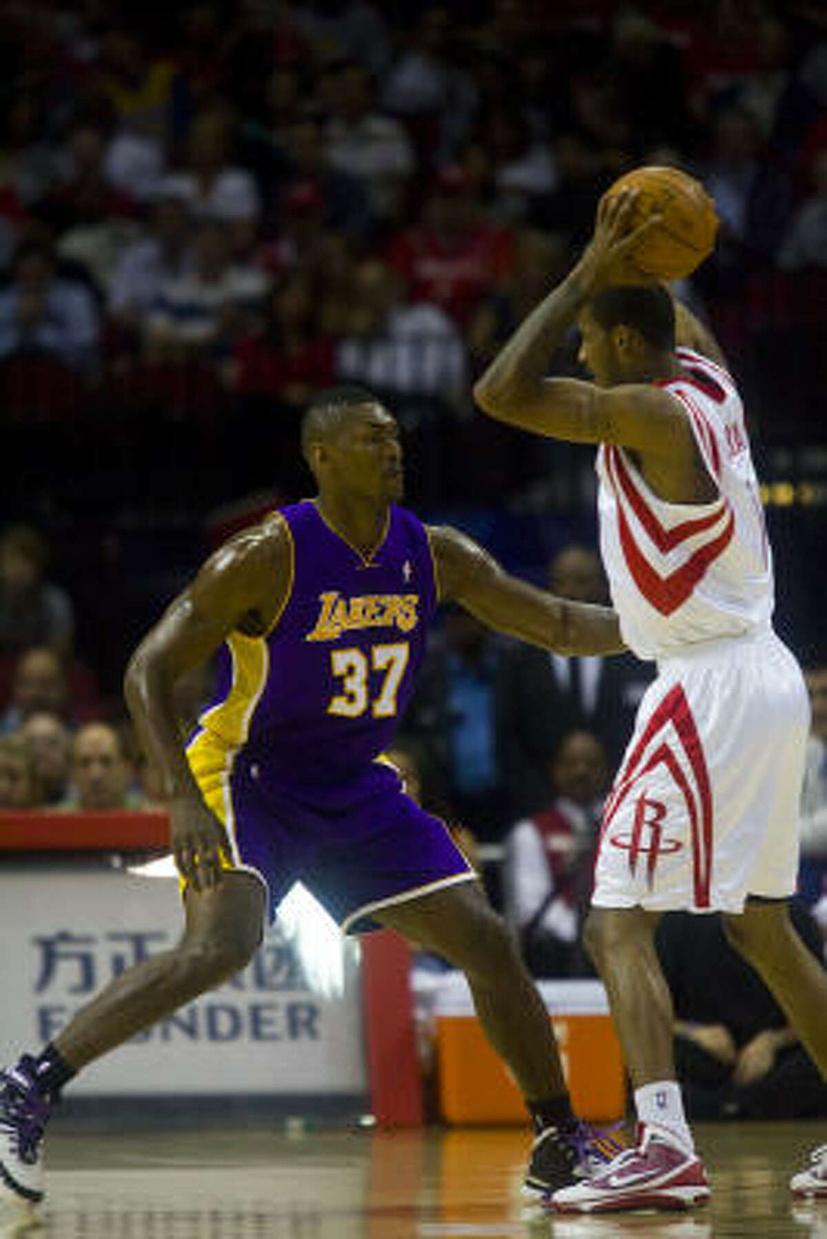 The Lakers' Ron Artest guards Rockets guard Trevor Ariza during the first half.