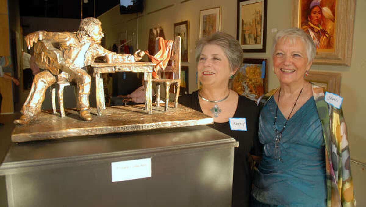 Kathy Gava, of Conroe, and Jean Fleshner, of The Woodlands, admire one of the sculptures on display at the Linda Watson Art Gallery during the art gallery's opening gala celebration in downtown Conroe. Joe and Jean Fleshner, of The Woodlands, recently opened the new art gallery.
