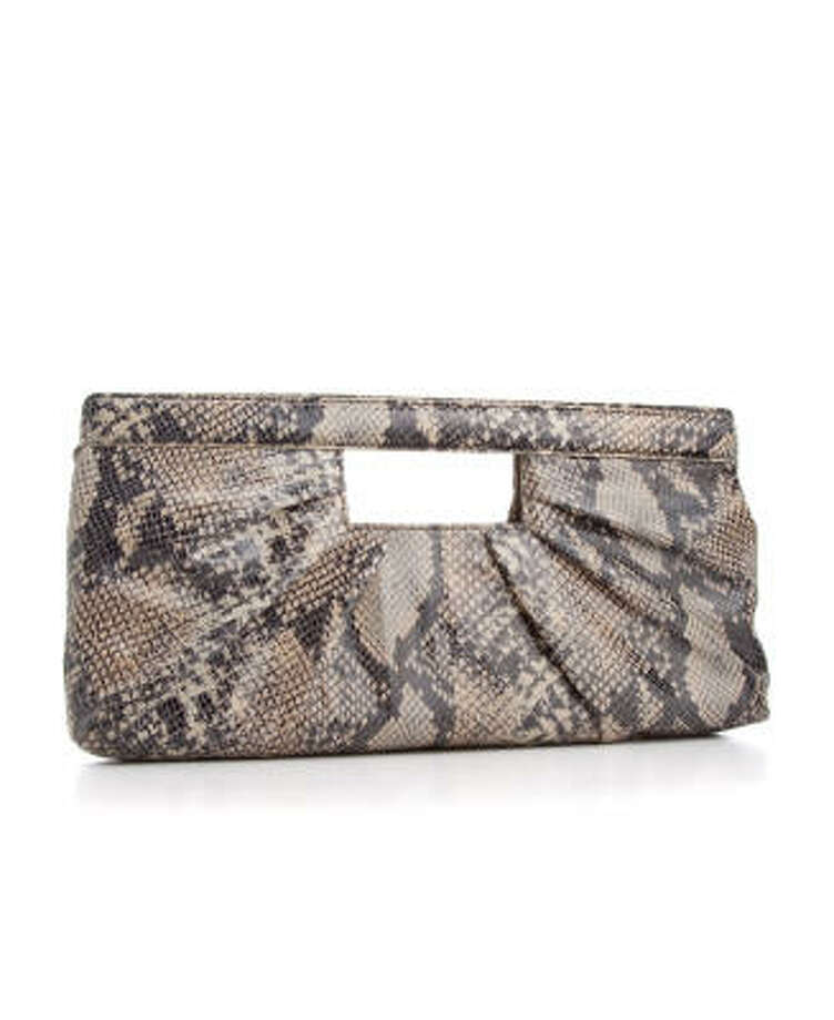 Tuck a trendy clutch such as this one by Alfani from Macy's into your briefcase for lunches outside the office. Animal prints are fine in small doses for daytime. Photo: Travis Rathbone, AP