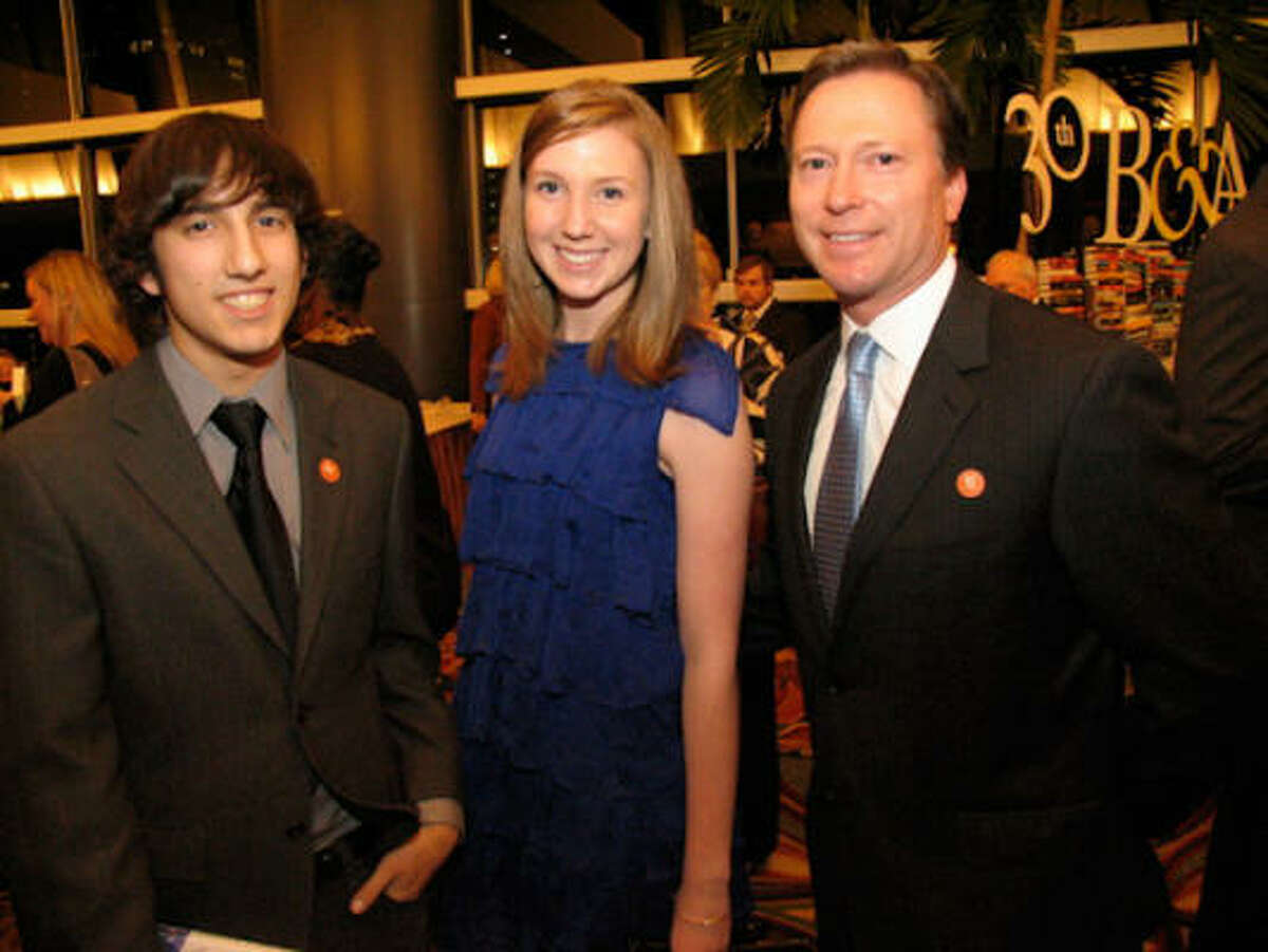 The Houston Chronicle Book & Author Dinner brought book-lovers together for cocktails, conversation and a meal at the Hilton Americas-Houston on Nov. 1. Pictured: Harry Hantel, left, and Megan and Greg Ebel.