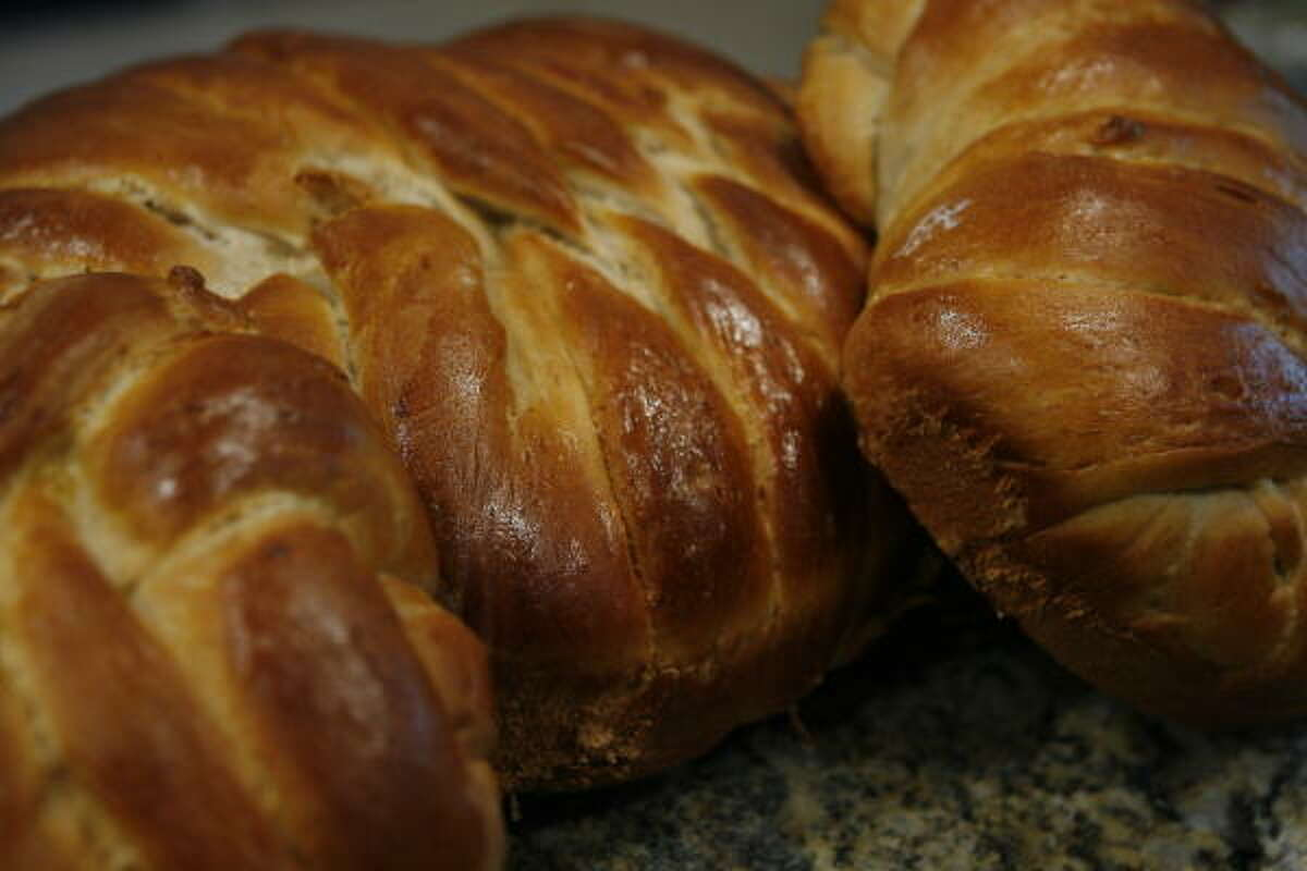 Challah bread The normally braided bread is usually baked into a round shape to represent the cycle of a new year.