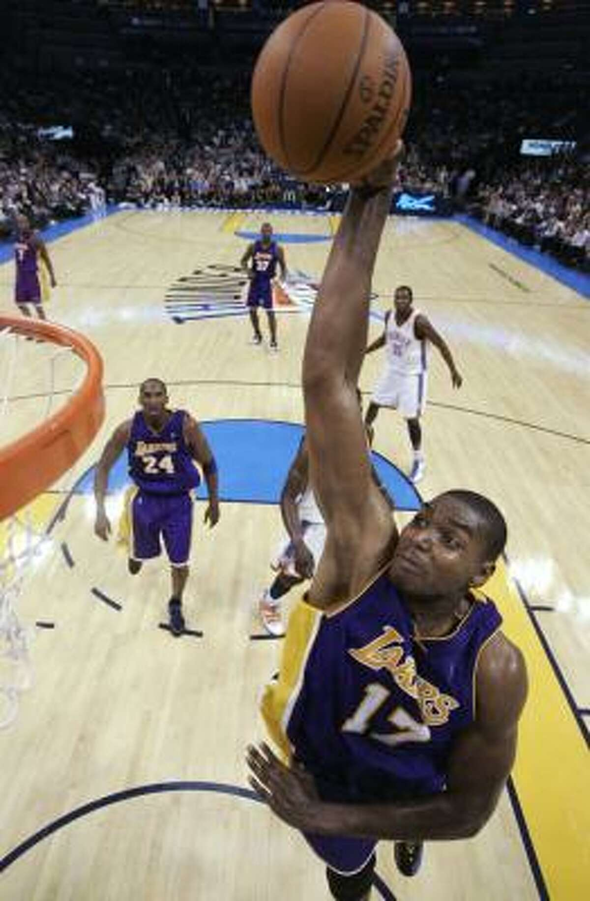 Lakers center Andrew Bynum goes hard to the basket against the Oklahoma City Thunder.