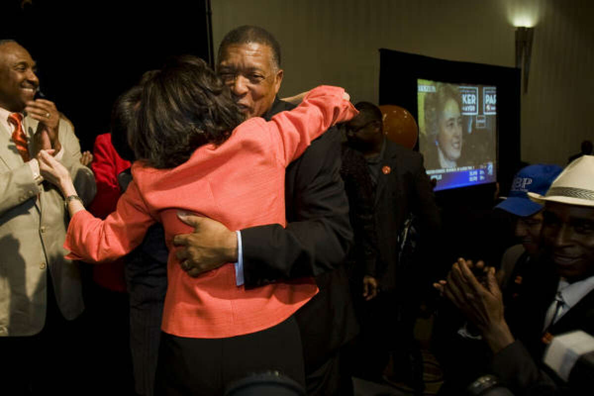City of Houston mayoral candidate Gene Locke gets a hug from supporter Helen Lee at the downtown Hyatt Regency on Election Night Tuesday.