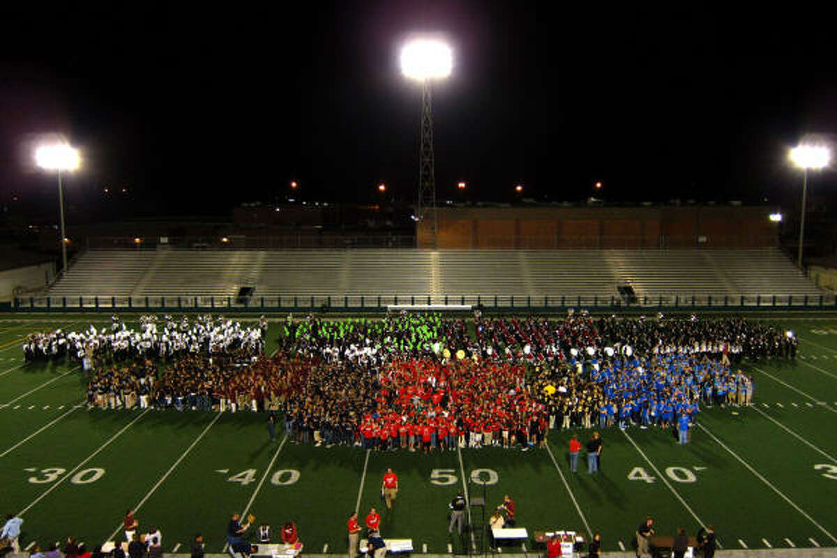 On the field all at once: Clear Creek ISD's four high school marching bands, plus eighth-grade band students from the district's intermediate schools.