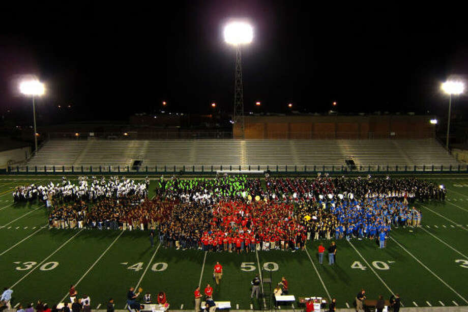 On the field all at once: Clear Creek ISD's four high school marching bands, plus eighth-grade band students from the district's intermediate schools. Photo: Kirk Swann, CCISD