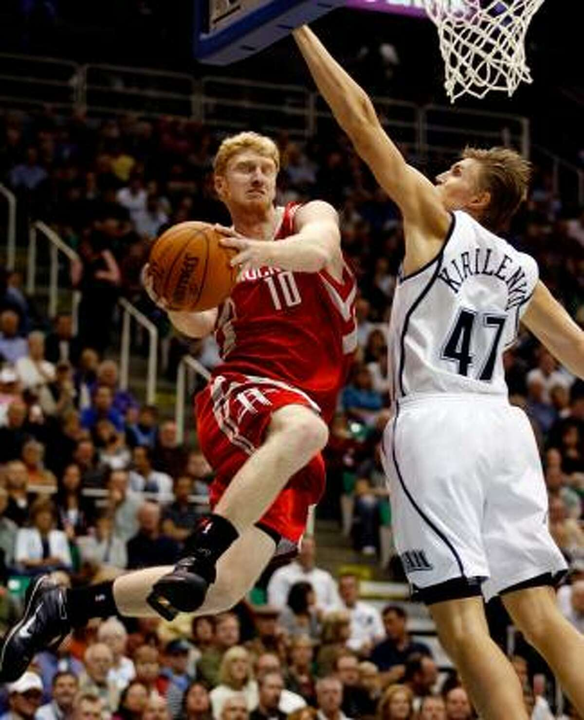 Rockets forward Chase Budinger goes to the basket past Jazz forward Andrei Kirilenko. Budinger had 17 points, a high for the rookie's young career.