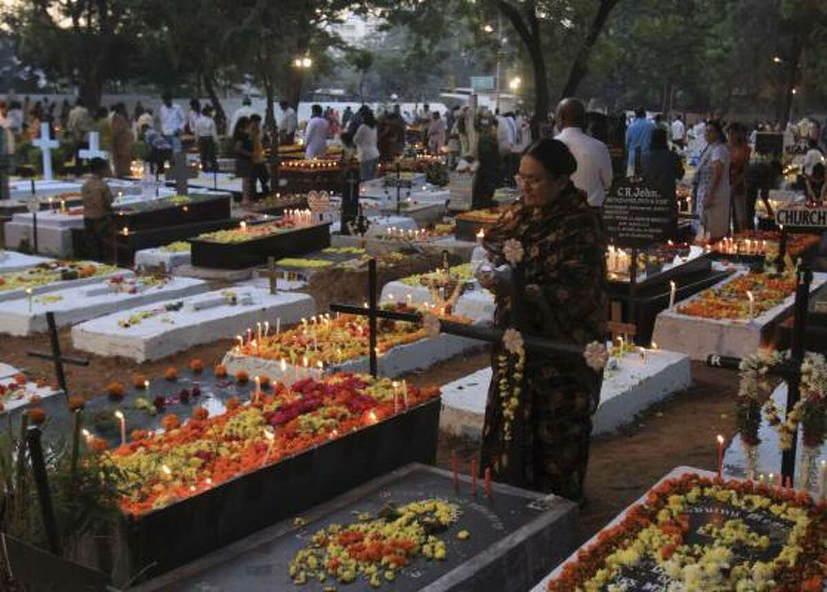 Christians decorate the graves of their relatives with flowers and candles on All Souls' Day in Hyderabad, India.