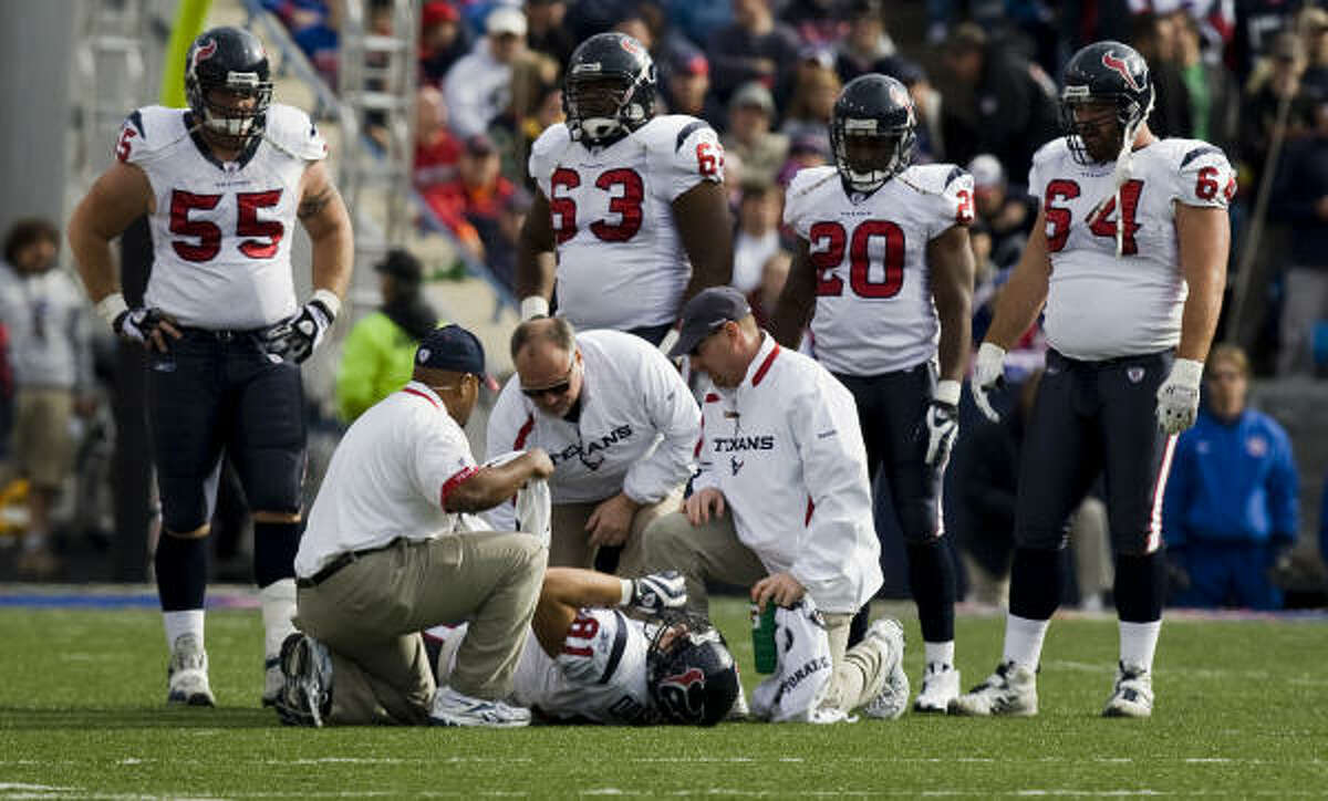 Texans tight end Owen Daniels (81) had the attention of trainers and teammates after going down with a knee sprain. Click here for story on Daniels' injury.