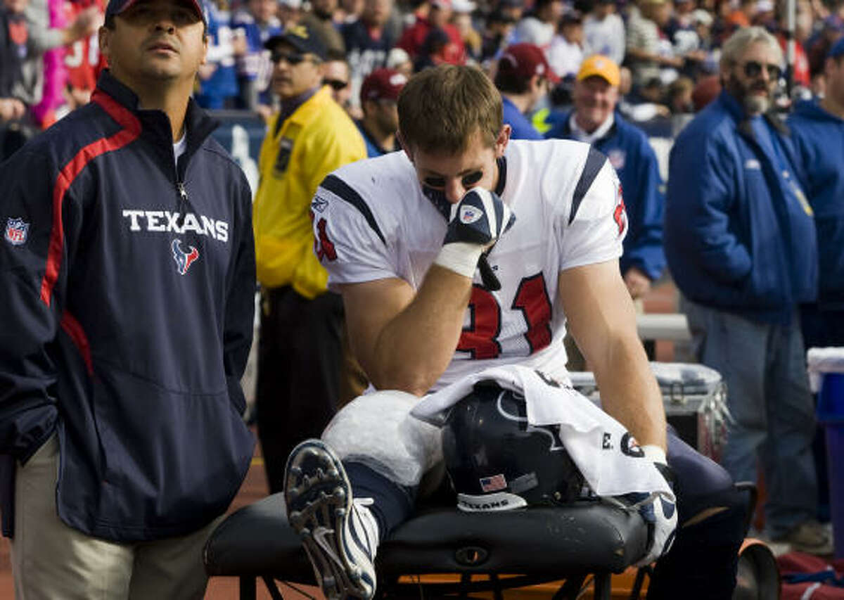 Texans tight end Owen Daniels sits on the bench after leaving Sunday's game with a sprained right knee.
