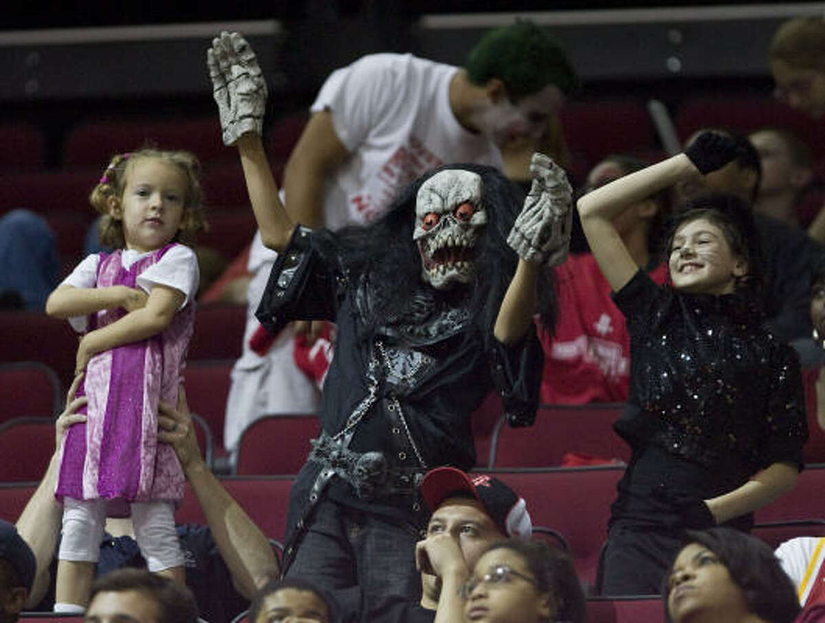 Fans show off their dance moves during the Rockets' 111-107 victory over the Portand Trail Blazers on Saturday.