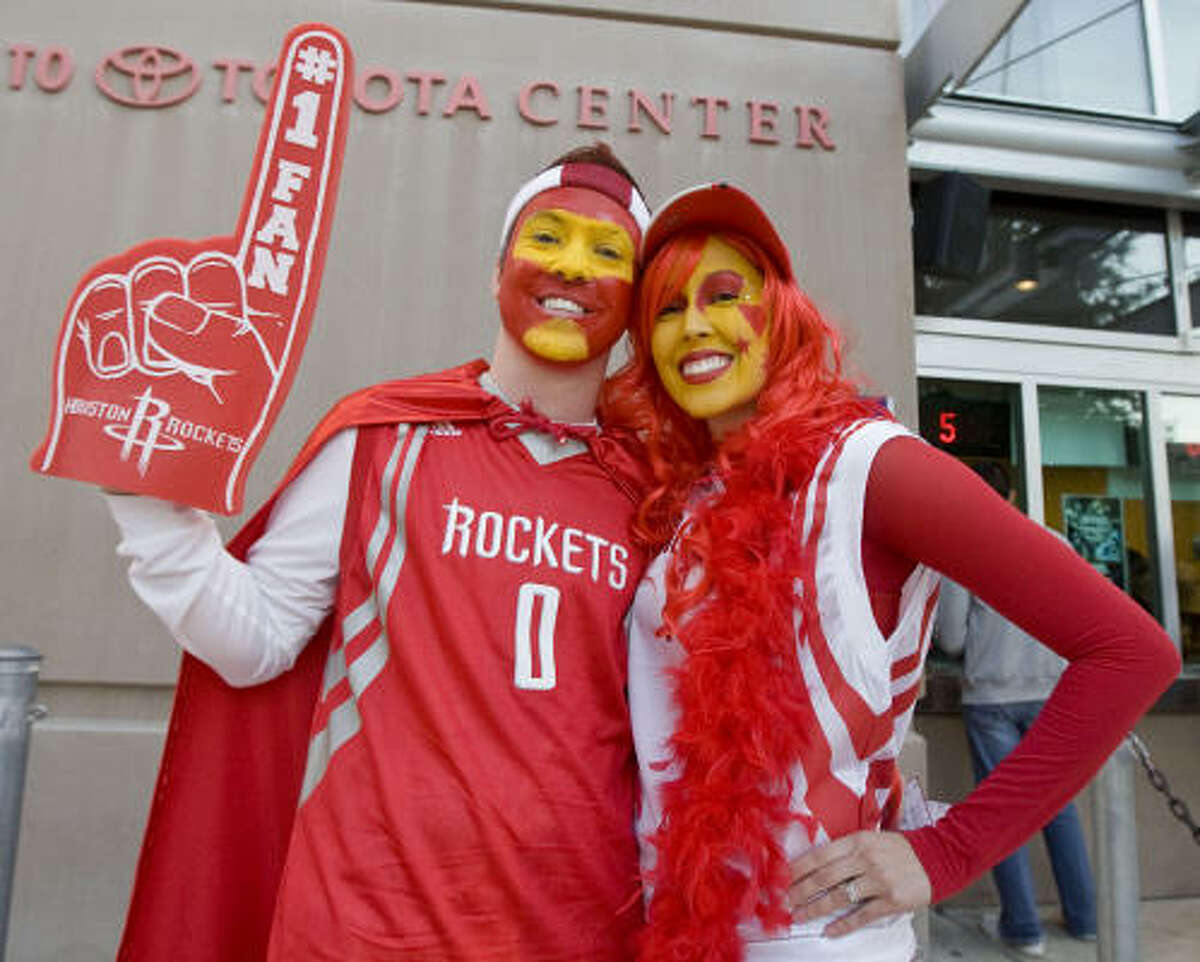 Mike Smith (left) and his wife Danielle Smith (right) arrive at the Toyota Center before the Houston Rockets face the Portland Trail Blazers on Saturday.