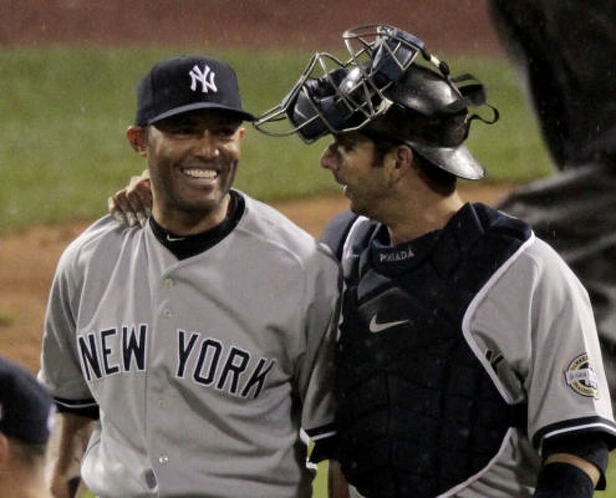Mariano Rivera, left, closed it out at 12:42 Eastern Daylight Time, making it the second time a World Series has gone into November. The first was in 2001 when baseball's schedule was pushed back a week because of the Sept. 11 terrorist attacks.