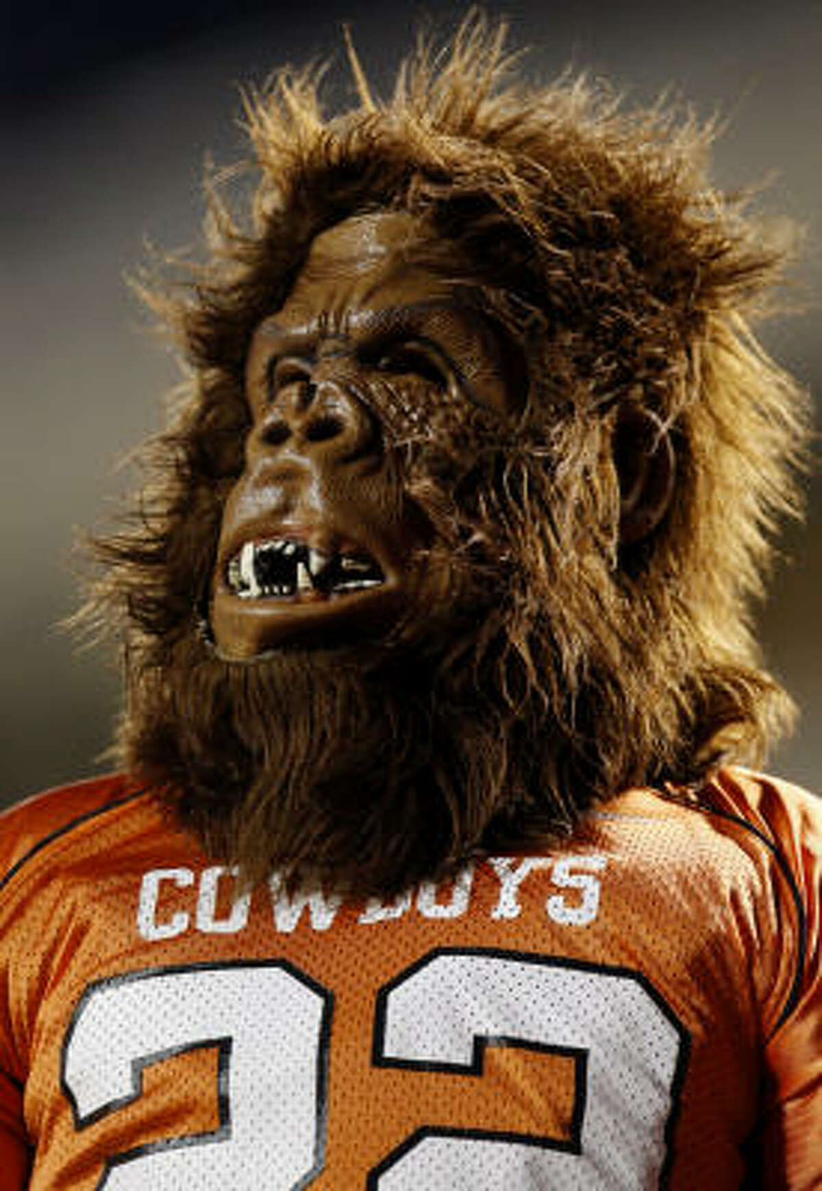 A fan of the Oklahoma State Cowboys celebrates the spirit of Halloween at the game against the Texas Longhorns at Boone Pickens Stadium on Saturday.