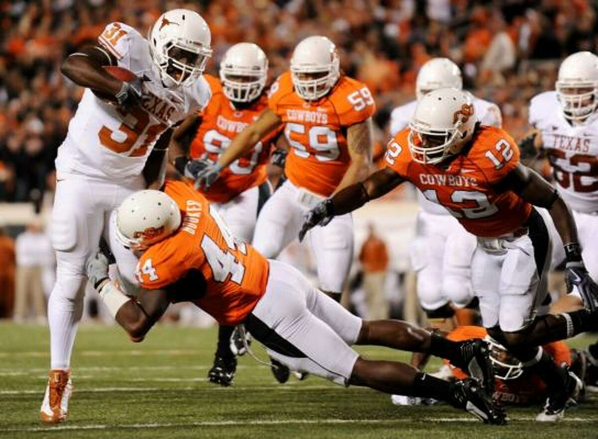 Cody Johnson rumbles toward the goal line against Oklahoma State defenders in the fourth quarter.
