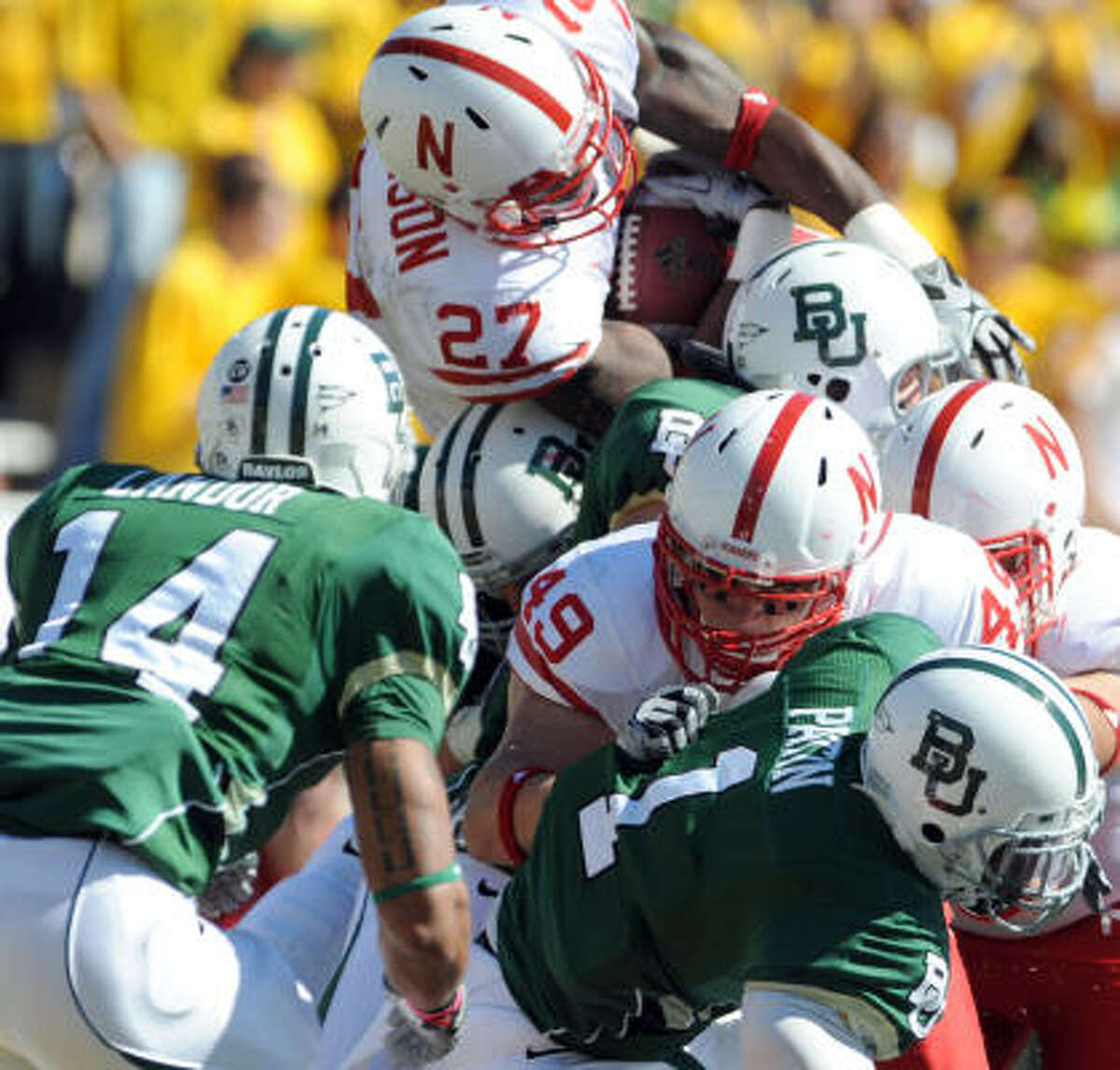 Nebraska Dontrayevous Robinson scores in the second quarter over Baylor's Byron Landor (14) and Earl Patin during Saturday afternoon's game in Waco.