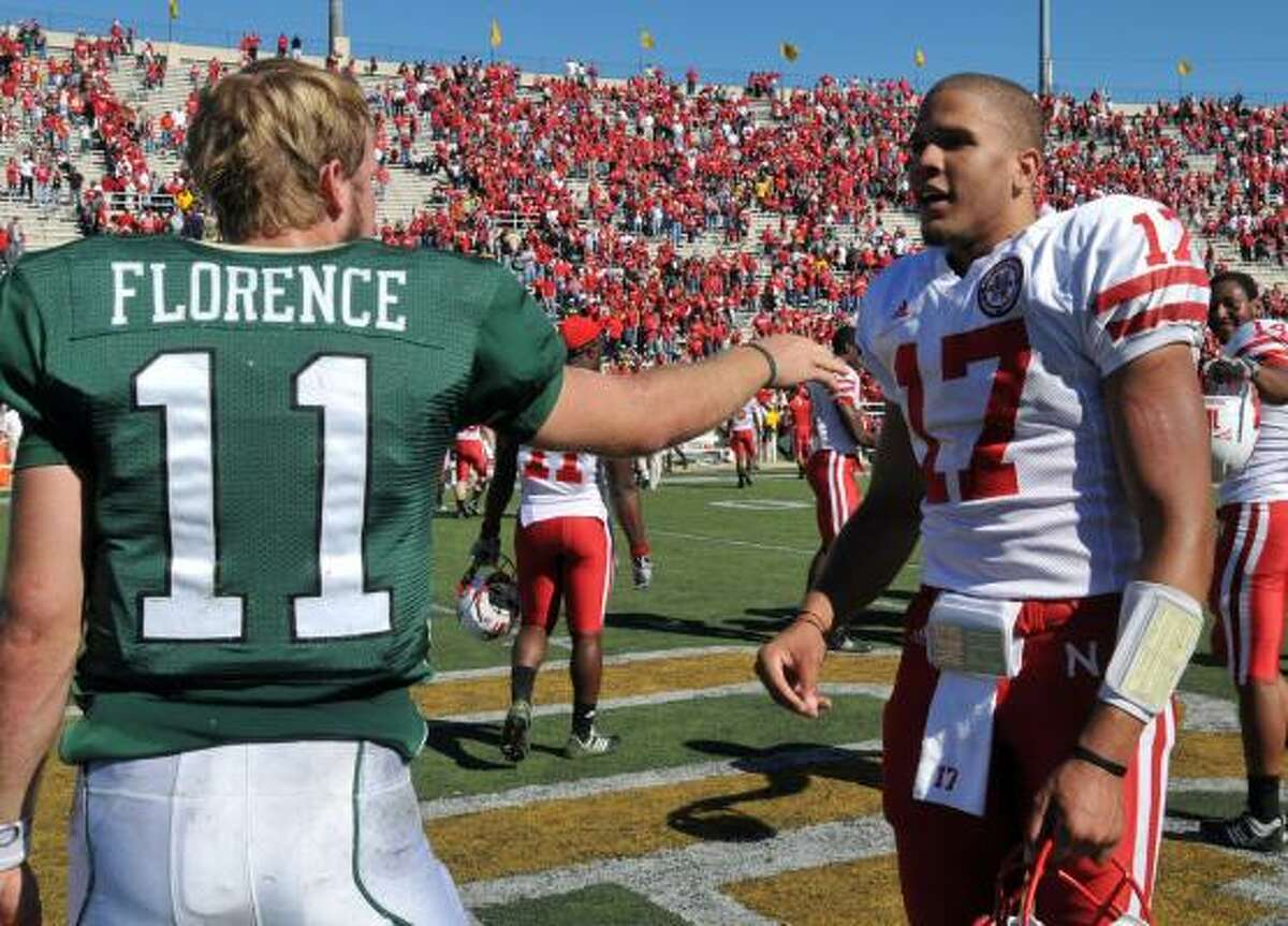 Baylor quarterback Nick Florence shakes hands with Nebraska's Cody Green after the game.