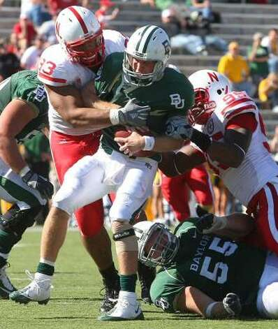 Baylor quarterback Nick Florence is tackled by Nebraska's Matt O'Hanion, left, and Pierre Allen. Photo: Jerry Larson, Associated Press