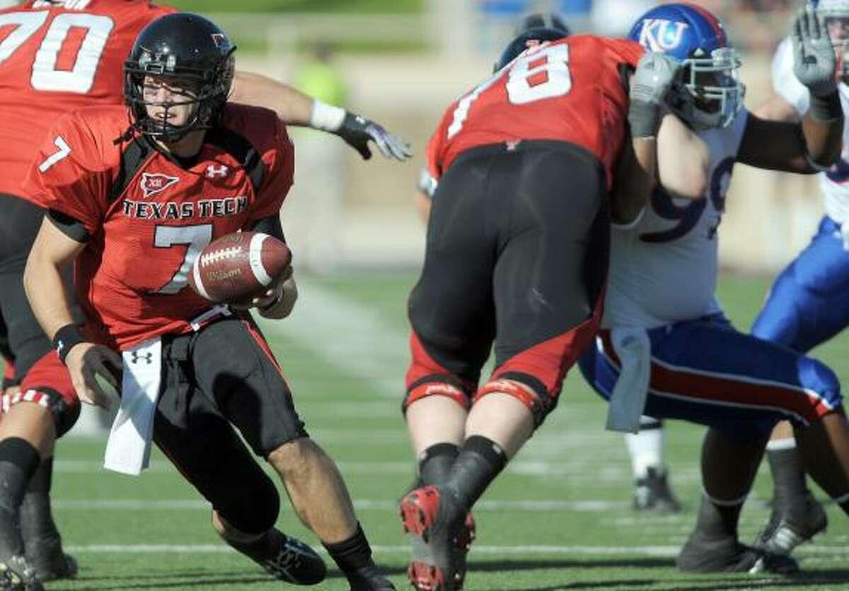 Tech quarterback Seth Doege hands off the ball against Kansas.