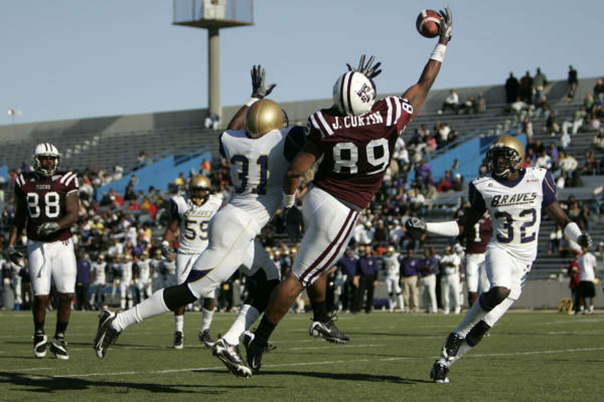 Texas Southern's Jordan Curtin hauls in a third-quarter touchdown reception past Alcorn State's Carl Harris (31) and Mark Nyainda.