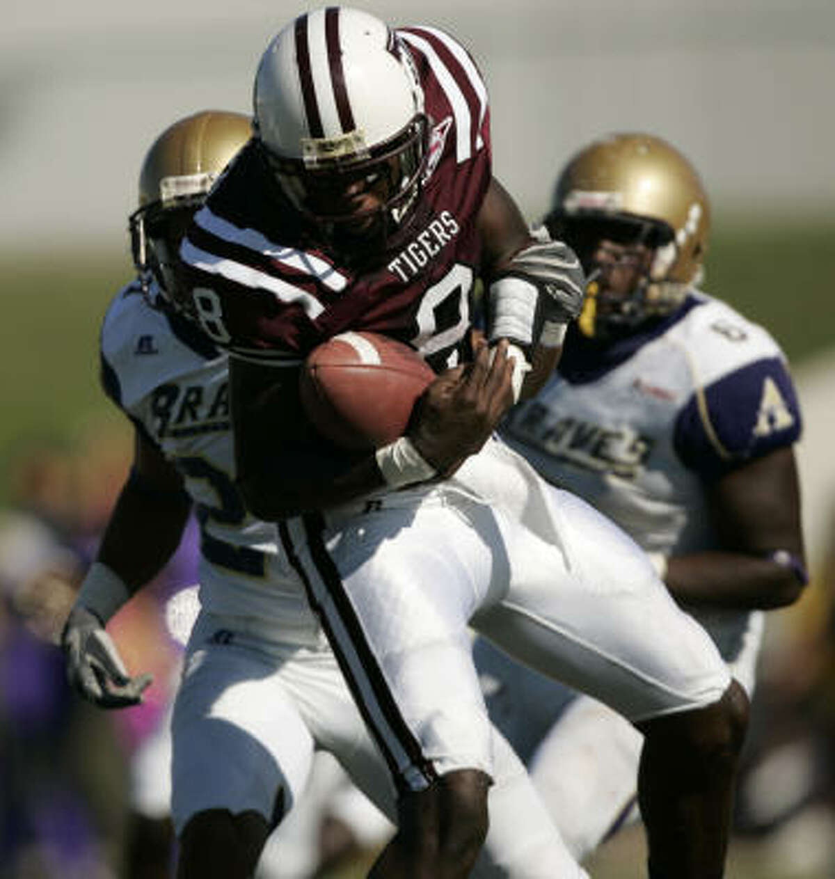 Texas Southern's Arvell Nelson tries to maintain possesion as Alcorn State's Kirderra Hall barrels in for a sack.