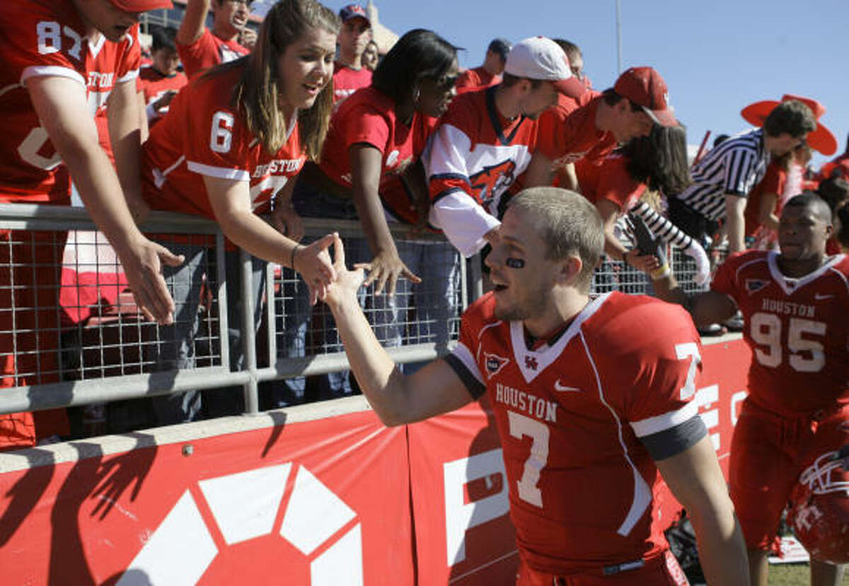 University of Houston quarterback Case Keenum receives congratulations from fans after UH's wild victory against Southern Miss on Saturday afternoon at Robertson Stadium. Keenum threw for a career-high 559 yards and five touchdowns.