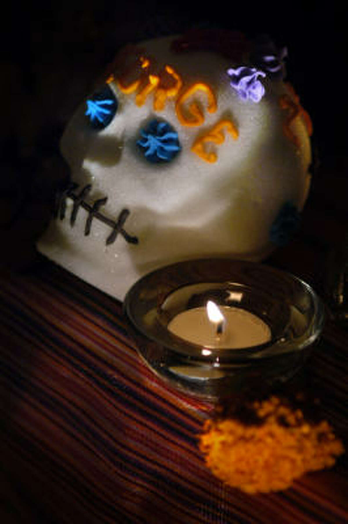 A sugar skull is one of the usual items placed on an altar in remembrance for Day of the Dead. Read about Hugo's Day of the Dead celebration here.