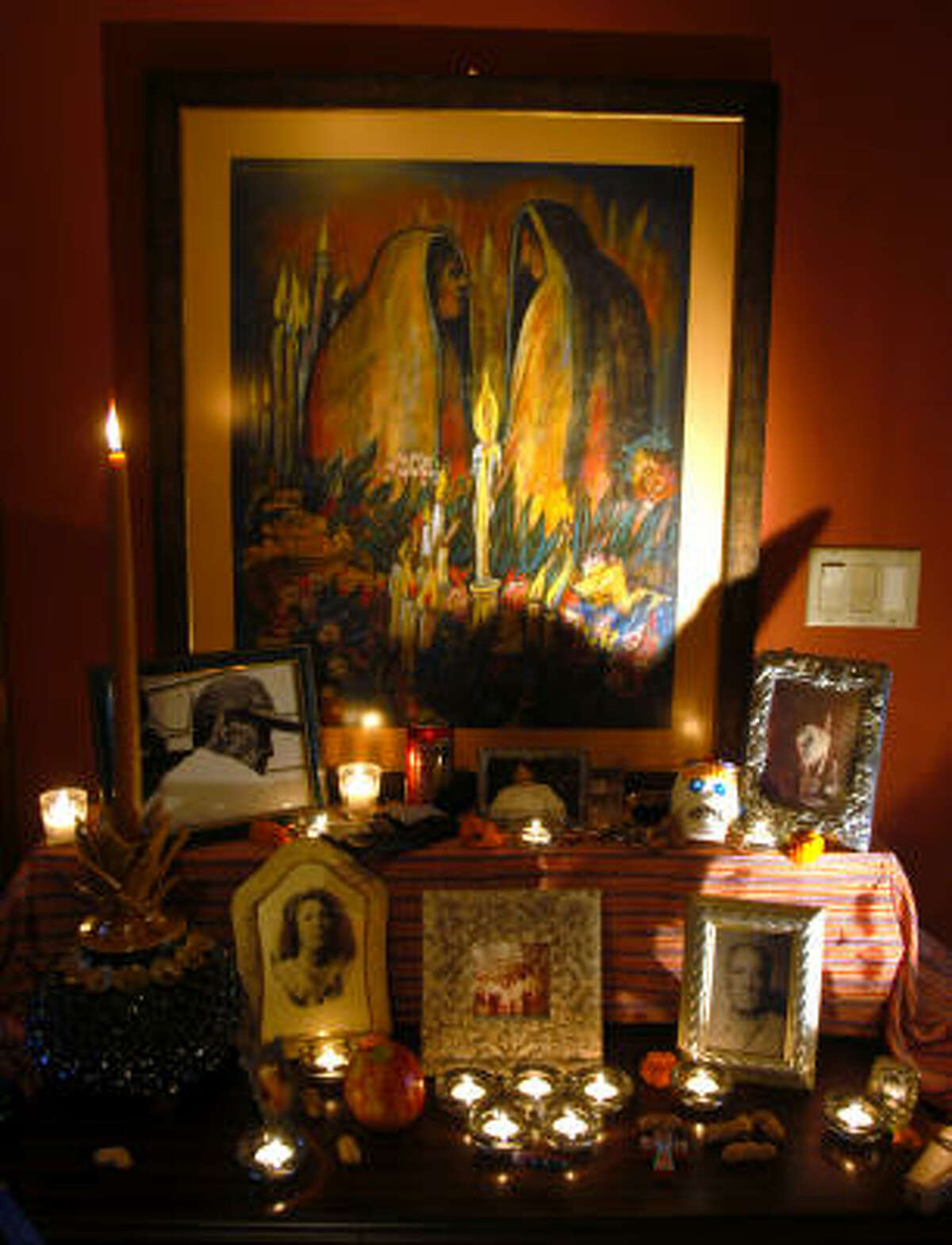 Bitty Truan of Rancho Viejo honors the memory of her late husband, George Truan, who was a professor of Art at UTB-TSC in Brownsville. Other relatives and friends also are remembered with photgraphs, personal effects and favorite food items. The altar is shown on Oct. 29, 2006.