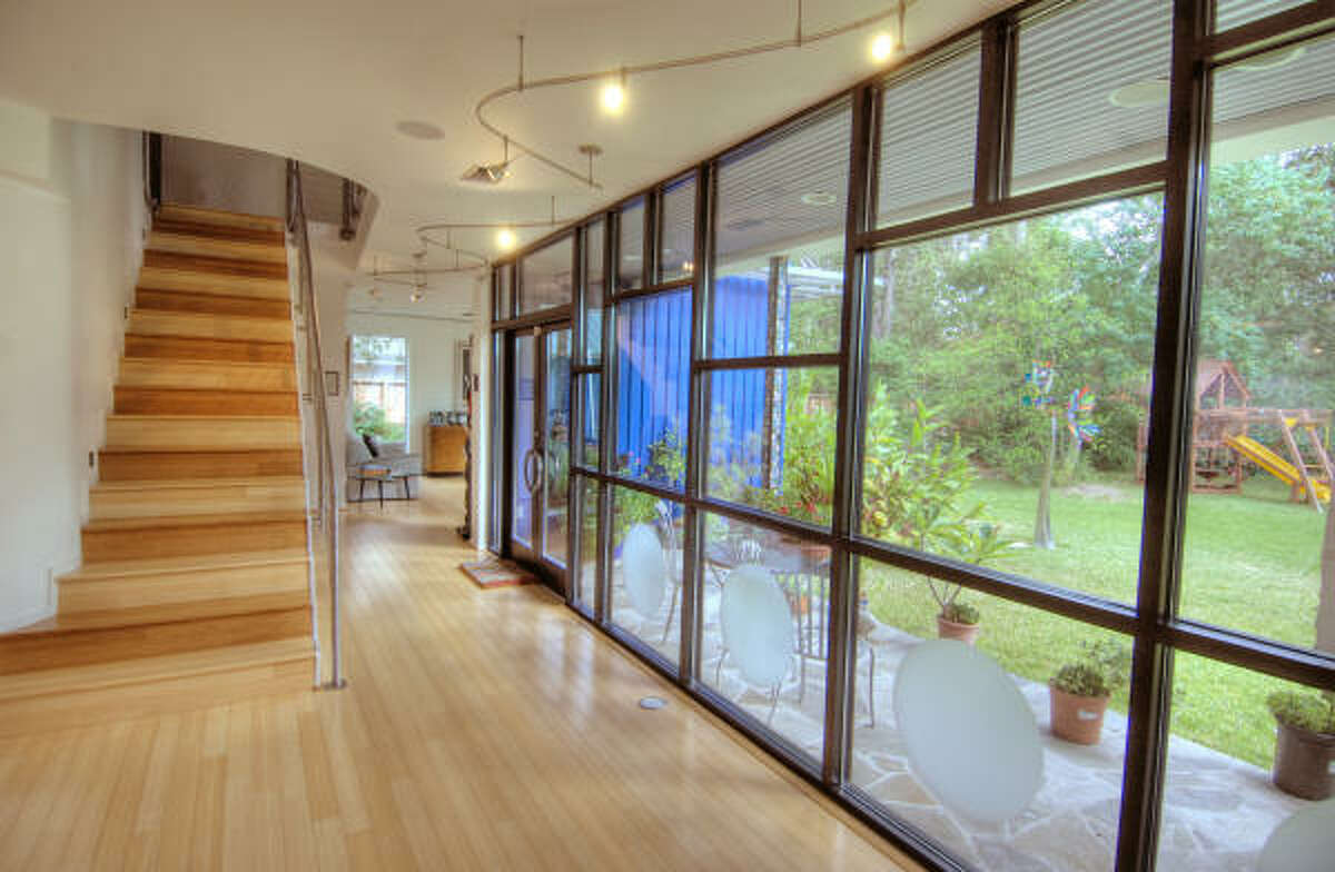 Shown are bamboo floors and large windows for natural light.