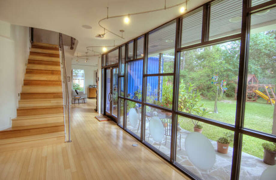 Shown are bamboo floors and large windows for natural light. Photo: Jerry Powers Photo