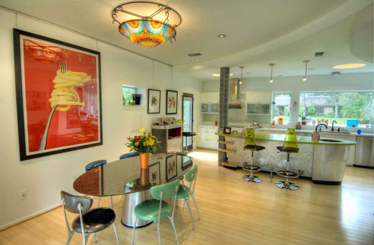 Eco-friendly flooring contines in the modern-designed kitchen, which also boasts windows for natural light.