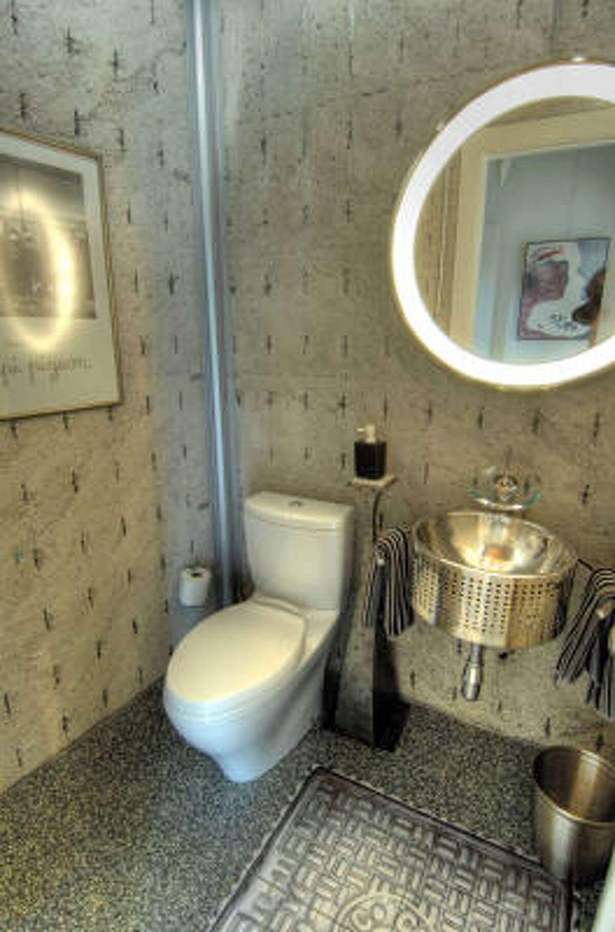 These bathroom floors are made of ground-up tires. Walls are exposed concrete containing bits of Styrofoam to lessen the amount of of cement needed.