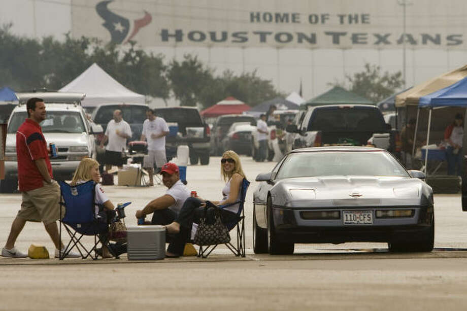 Tailgaters set up in the parking lot before the Texans' 2009 season opener against the New York Jets at Reliant Stadium on Sept. 13. Photo: Smiley N. Pool, Chronicle