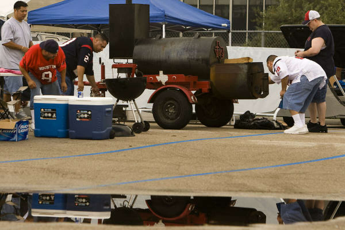 Tailgaters get ready to grill before the Jets game.