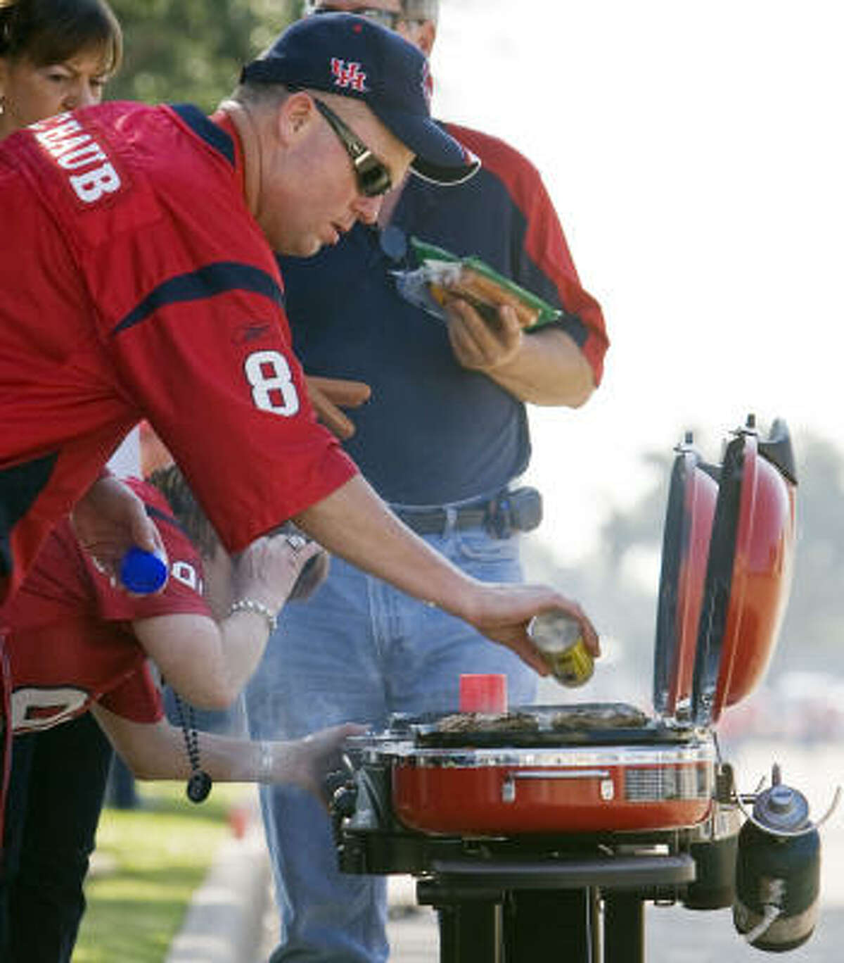 Rodney Crouch of Seabrook mans the grill before the game against Jacksonville.