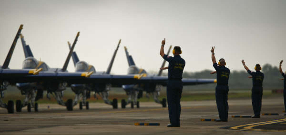 The Blue Angels' maintenance crew stands ready for the pilots' arrival at Ellington Airport.
