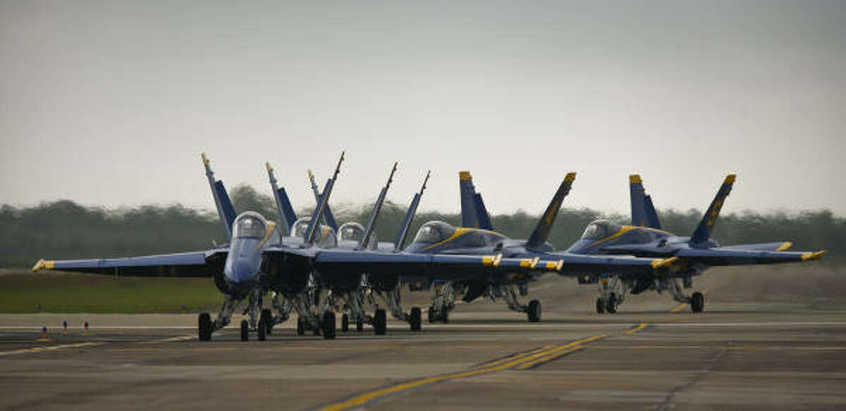 The Blue Angels roll down Ellington's runway.