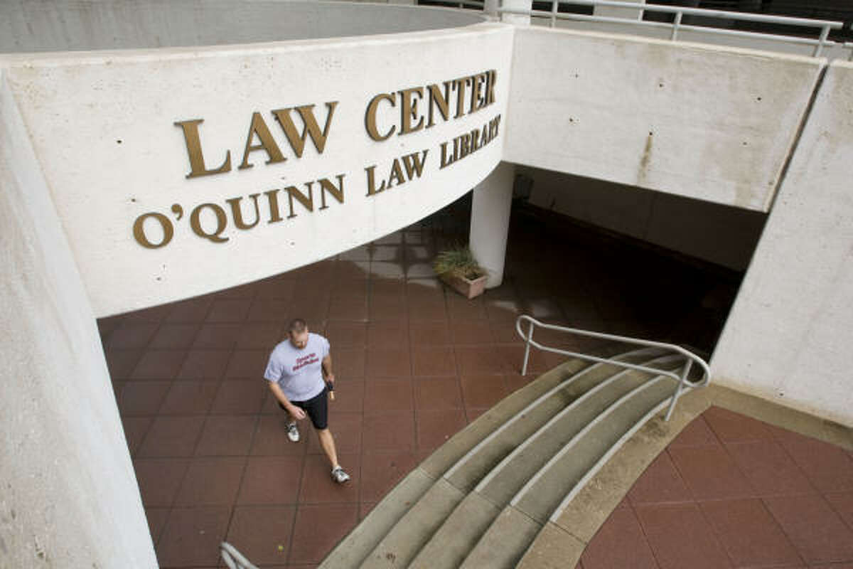 A student walks from the entrance of the John O'Quinn Library at the University of Houston Law School. The football field at the University of Houston's Robertson Stadium also is named for O'Quinn, a big UH supporter.