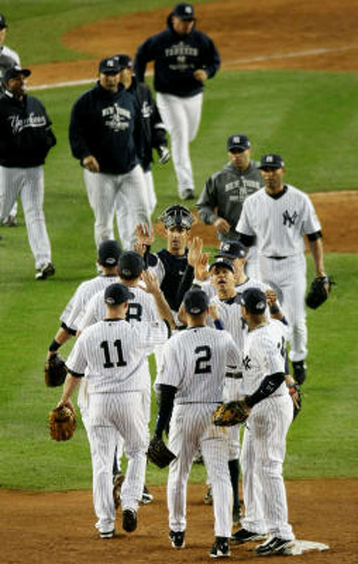 Game 2: Yankees 3, Phillies 1 The New York Yankees celebrate after defeating the Philadelphia Phillies in Game 2 of the World Series on Thursday night at Yankee Stadium.
