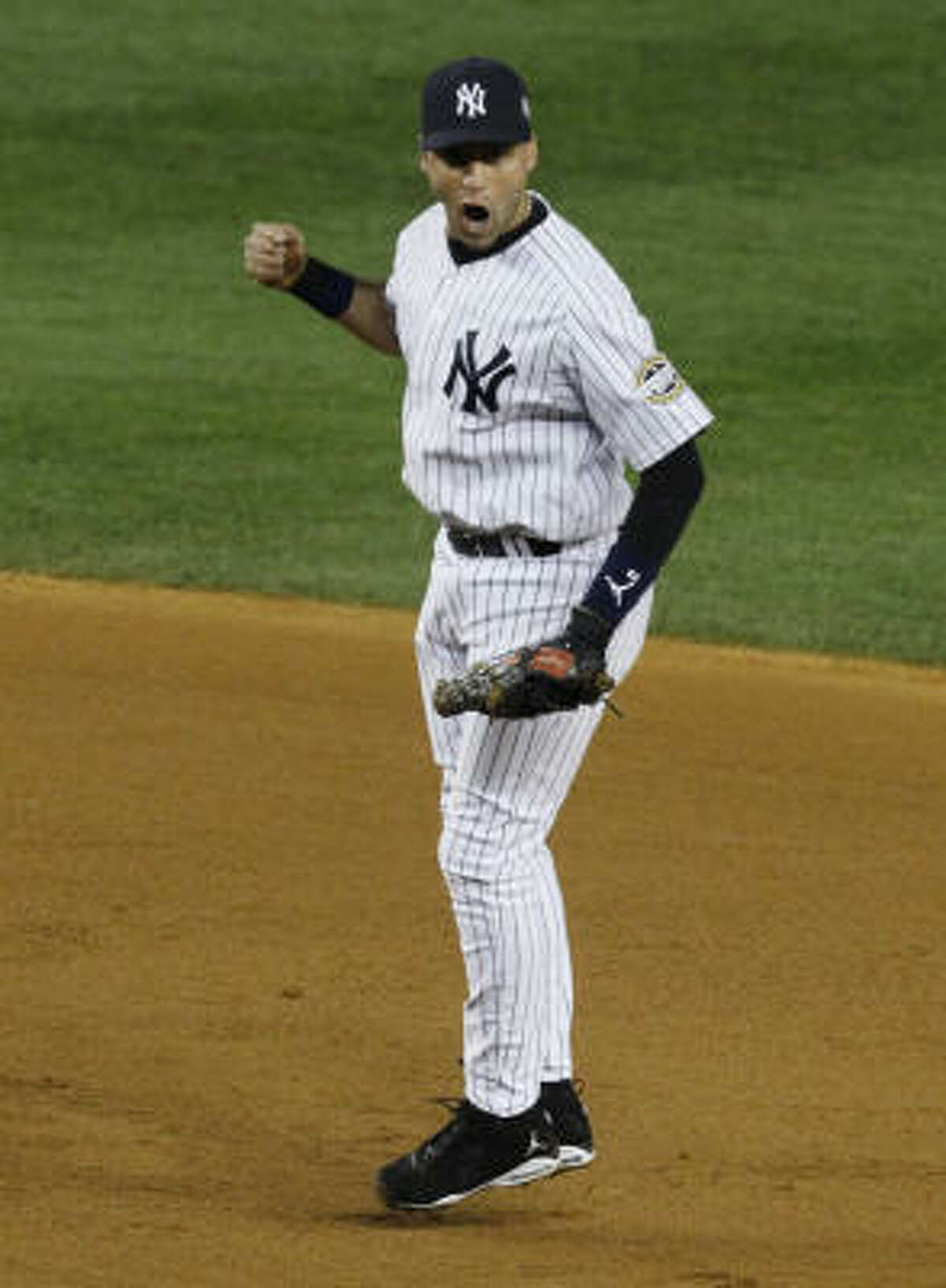 New York's Derek Jeter celebrates after an inning-ending double play in the eighth inning.