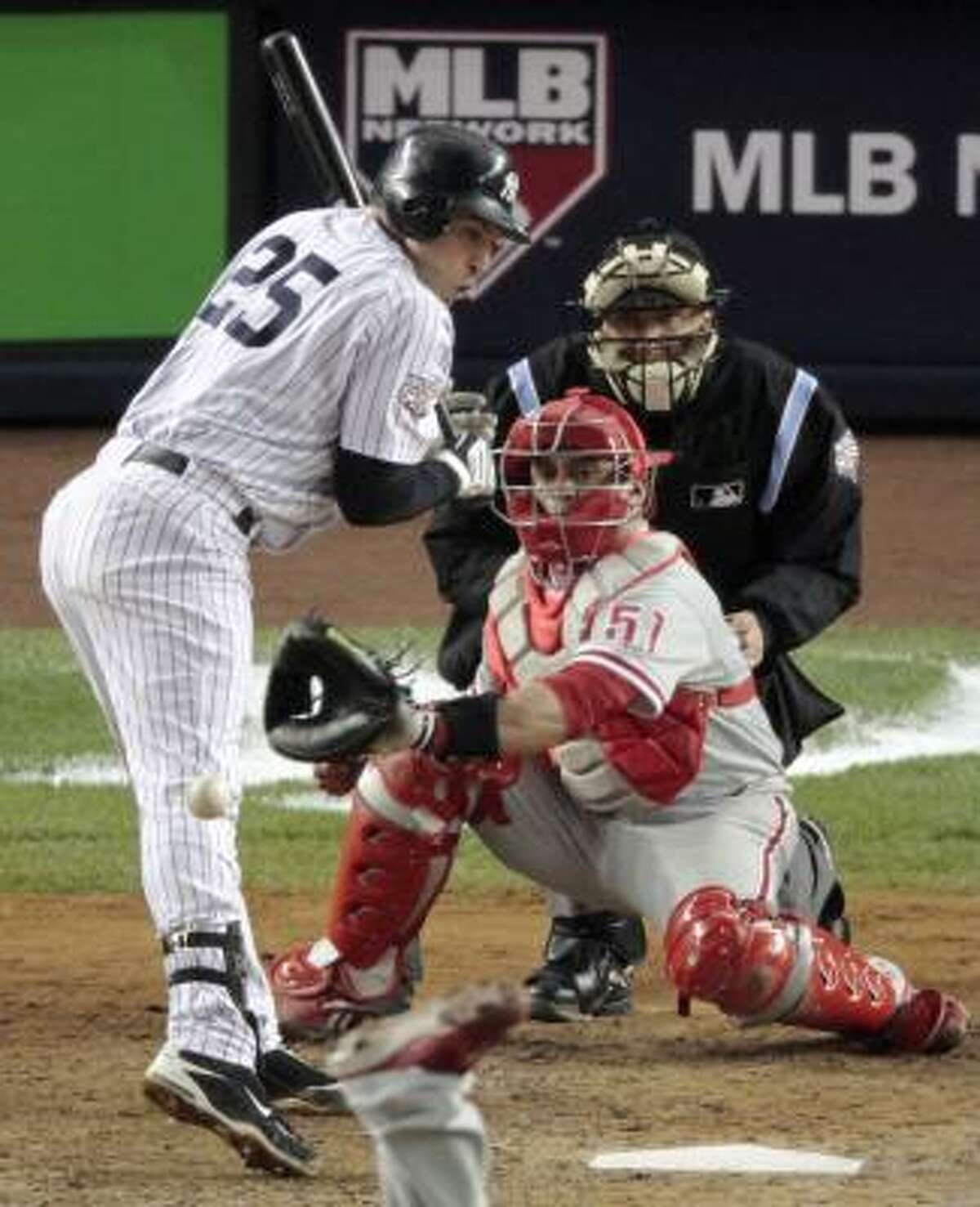 New York's Mark Teixeira is hit by a pitch during the eighth inning.