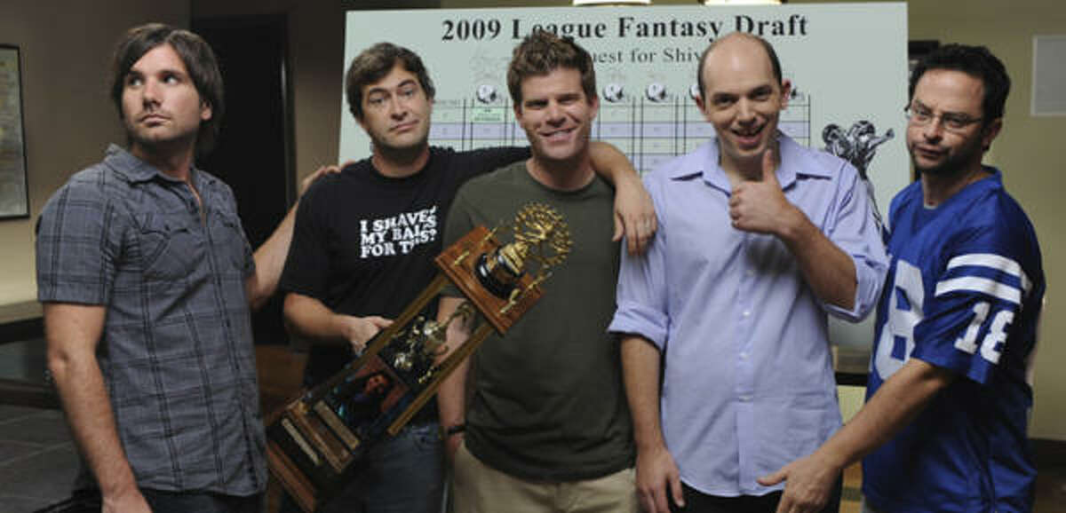 """TV critic Tim Goodman writes: The League focuses on Pete (Mark Duplass), second from left, a bit of a slacker married to Meegan (Leslie Bibb), who hates his addiction to """"faux"""" football. But Pete has won the league three of the past four seasons, so he's not quitting anytime soon, even if it jeopardizes his marriage. Read the full review of The League here."""