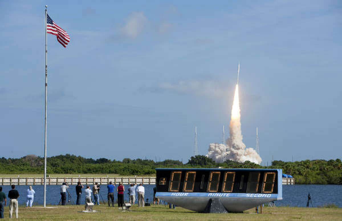 People gathered to watch the launch of the Ares 1-X test rocket, designed by NASA to be part of the spacecraft that will replace the space shuttle fleet.