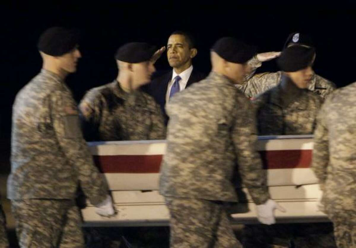 President Barack Obama salutes as Sgt. Dale R. Griffin's remains pass. Obama honored the return of 18 fallen Americans Thursday. All were killed this week in Afghanistan, a brutal stretch that turned October into the most deadly month for U.S. troops since the war began. More on Obama's trip here.