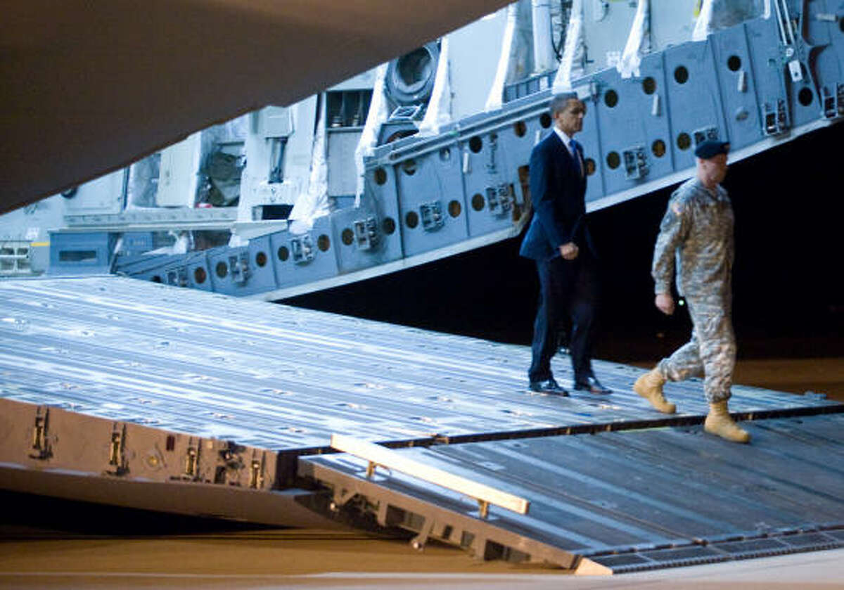 President Barack Obama walks off a C-17 airplane during the transfer of Sergeant Dale R. Griffin of Terre Haute, Ind. More on Obama's trip here.